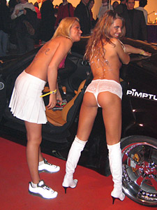 Extasia Zurich, topless girls in front of a tuned car
