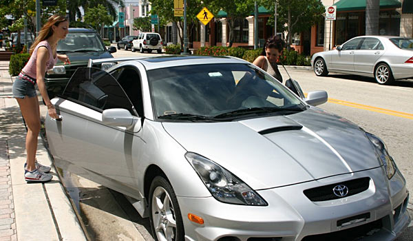 Two very sexy girls with big tits drive in a Celica 1